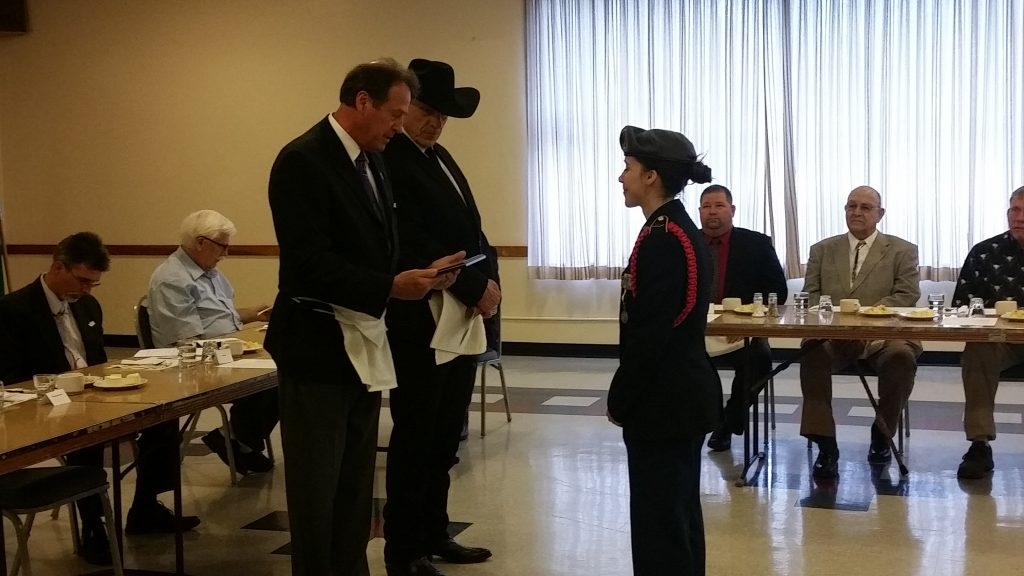 Cadet Mariam Hart receiving awards for service to the community from Right Worshipful Warren Schoeben and Worshipful Master Al Conetto